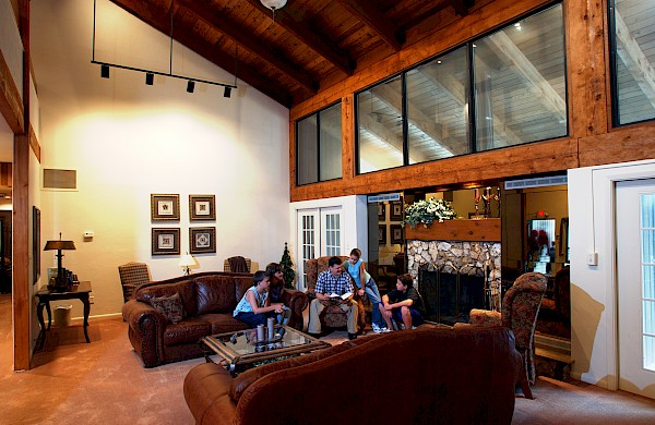 Family Reading in Great Room at Stillwaters Lodge Retreat and Conference Center, FL